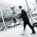 businessman with trolley at the airport, motion blurred